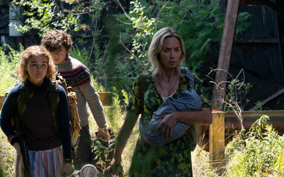 """L-r, Regan (Millicent Simmonds), Marcus (Noah Jupe) and Evelyn (Emily Blunt) brave the unknown in """"A Quiet Place Part II."""""""