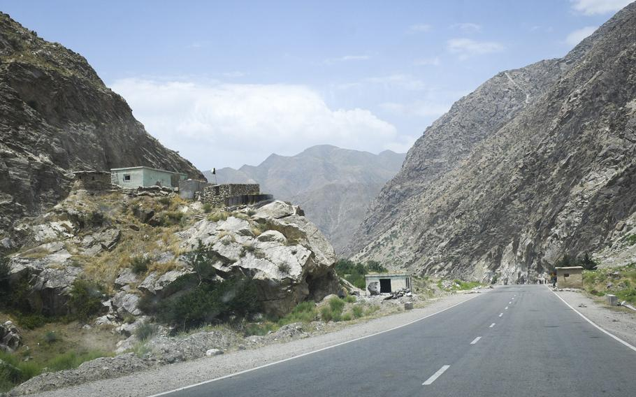 An Afghan police checkpoint near the neck of a narrow and winding valley overlooks a paved road to Faizabad, the provincial capital of remote Badakhshan province on July 14, 2019. Faizabad was once a stronghold against the Taliban but has fallen to the militant group, local leaders said Aug. 11, 2021.