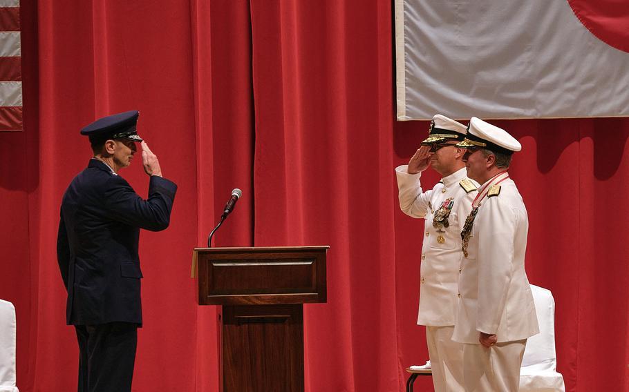 The commander of U.S. Forces Japan, Air Force Lt. Gen. Kevin Schneider, left, presides over a change-of-command ceremony for U.S. Naval Forces Japan and Navy Region Japan at Yokosuka Naval Base, Japan, Wednesday, July 14, 2021.