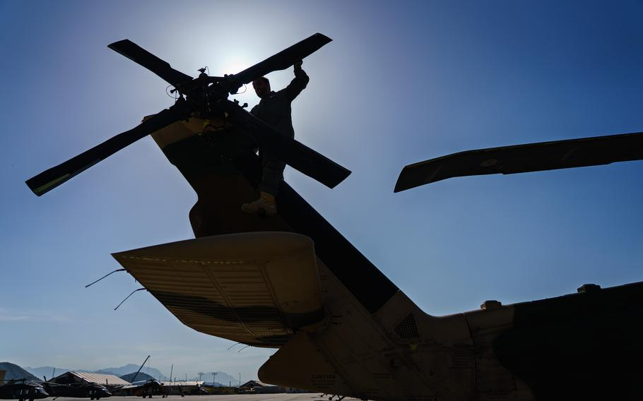An Afghan air force UH-60 crew inspects the tail rotor during preflight check at Kabul Airbase in Afghanistan.