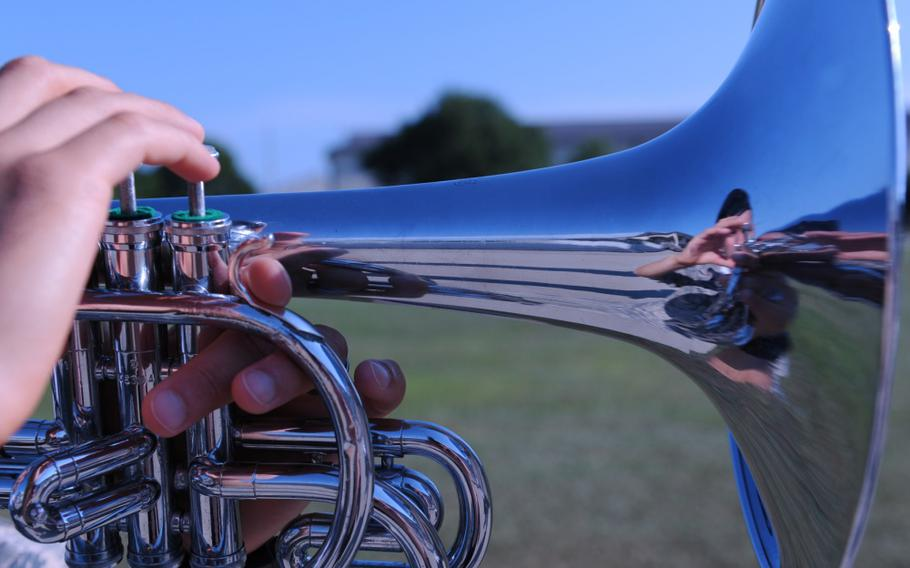 An airman plays a mellophone during a practice session at Keesler Air Force Base, Miss. on May 31, 2016.