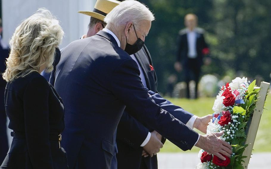 President Joe Biden and first lady Jill Biden lay a wreath at the Wall of Names during a visit to the Flight 93 National Memorial in Shanksville, Pa., Saturday, Sept. 11, 2021.
