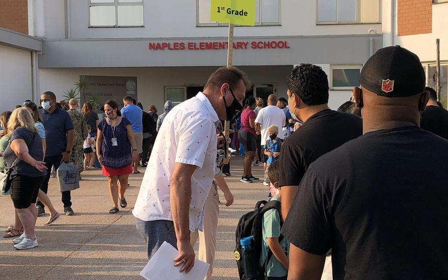 Teachers, parents and children line up outside Naples Elementary School on the Gricignano di Aversa site of Naval Support Activity Naples on Monday, Aug. 23, 2021.