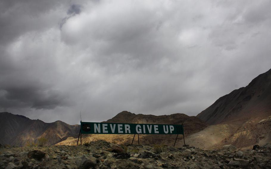 A banner erected by the Indian army stands near Pangong Tso lake near the India-China border in India's Ladakh area in 2017. Top Indian and Chinese army commanders met Saturday, July 31, 2021, after a gap of three months to discuss the expeditious disengagement of thousands of forces in the mountains of the eastern Ladakh region to ease the 15-month border tensions.