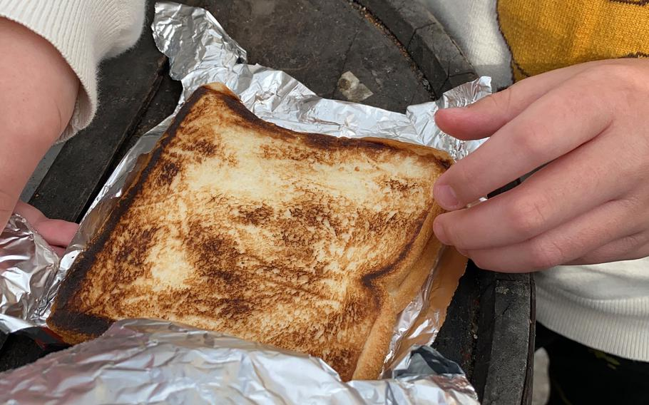The toasted sandwiches from a retro vending machine outside Used Tire Market in Sagamihara, Japan, pop out wrapped in piping hot aluminum foil.