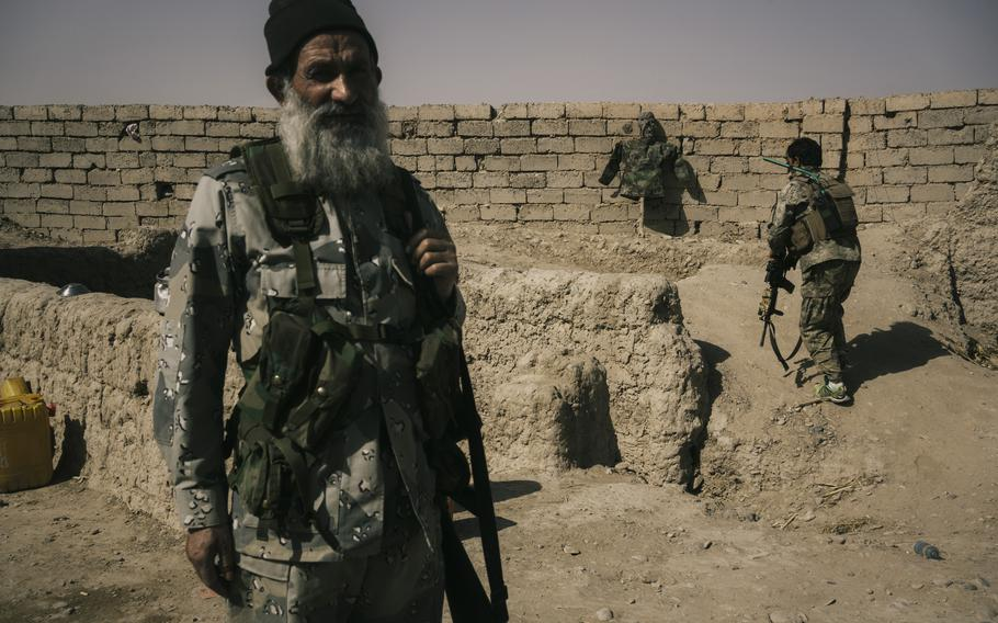 Afghan army soldiers occupy a position on the front line that is exposed to Taliban sniper fire at the Nazar outpost near Lashkar Gah on May 25, 2021.