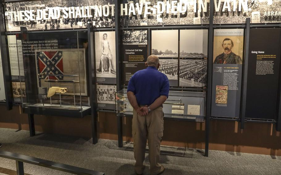 A visitor takes in the Civil War exhibit at the National Museum of the United States Army on its reopening day, June 14, 2021.