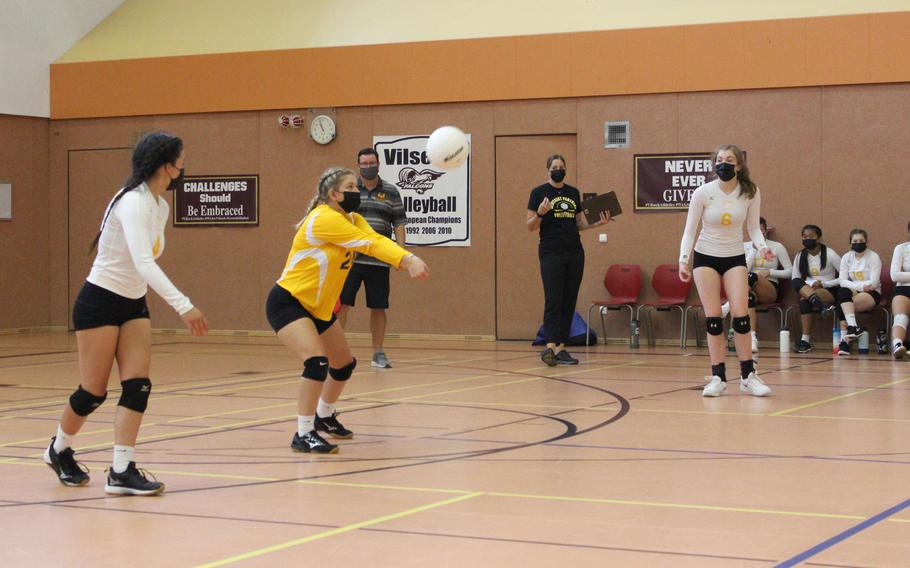 Stuttgart volleyball player McKenzie Maune lines up a pass alongside teammates Jazelyn Campbell, left, and Sofia Gentile.