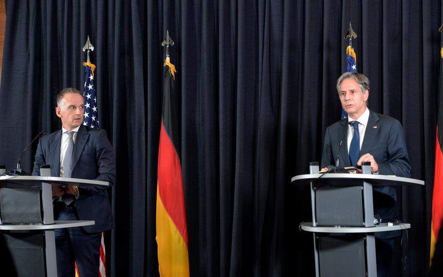 German Foreign Minister Heiko Maas, left, listens to his U.S. counterpart Secretary of State Antony J. Blinken answer a question at a press conference during their visit to Ramstein Air Base, Germany, Sept. 8, 2021. Blinken was at Ramstein to meet Afghan refugees, talk to U.S. service members and thank German Foreign Minister Heiko Maas and Germany for their help during the evacuation of tens of thousands of people from Afghanistan.