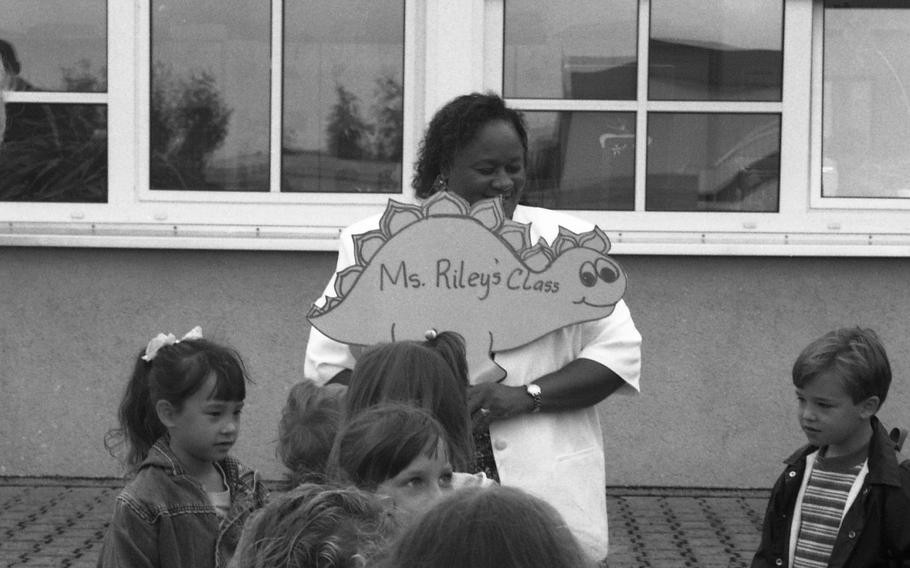 B.J. Riley gets her second-grade class in line before taking them in for the first day at Bad Kreuznach Elementary School in Germany on Aug. 29, 1995.