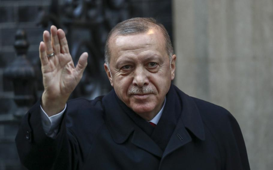 Recep Tayyip Erdogan, Turkey's president, gestures as he arrives for a multilateral meeting on the sidelines of the NATO summit in London, on Dec. 3, 2019.