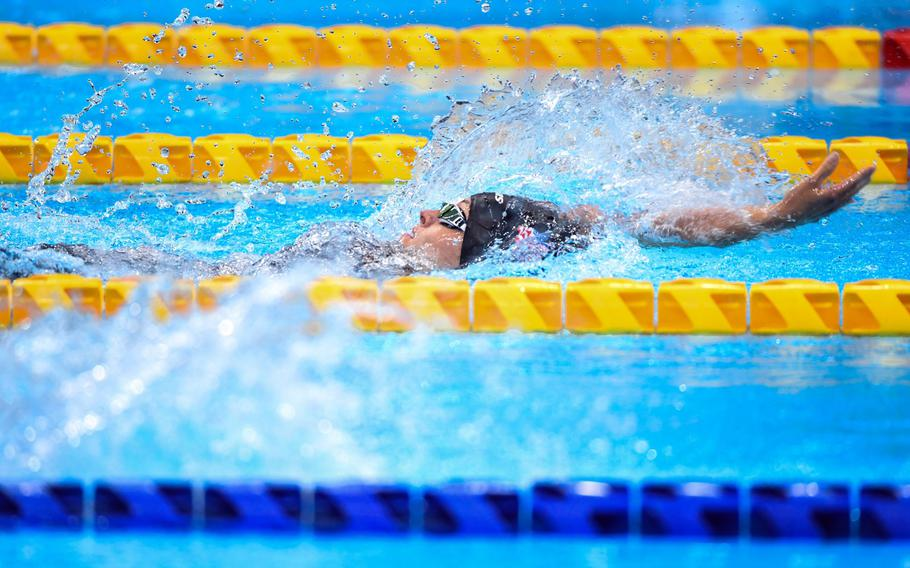 Army Sgt. 1st Class Elizabeth Marks swims backstroke on her way to a gold medal at Tokyo Aquatics Center on Friday, Sept. 3, 2021.