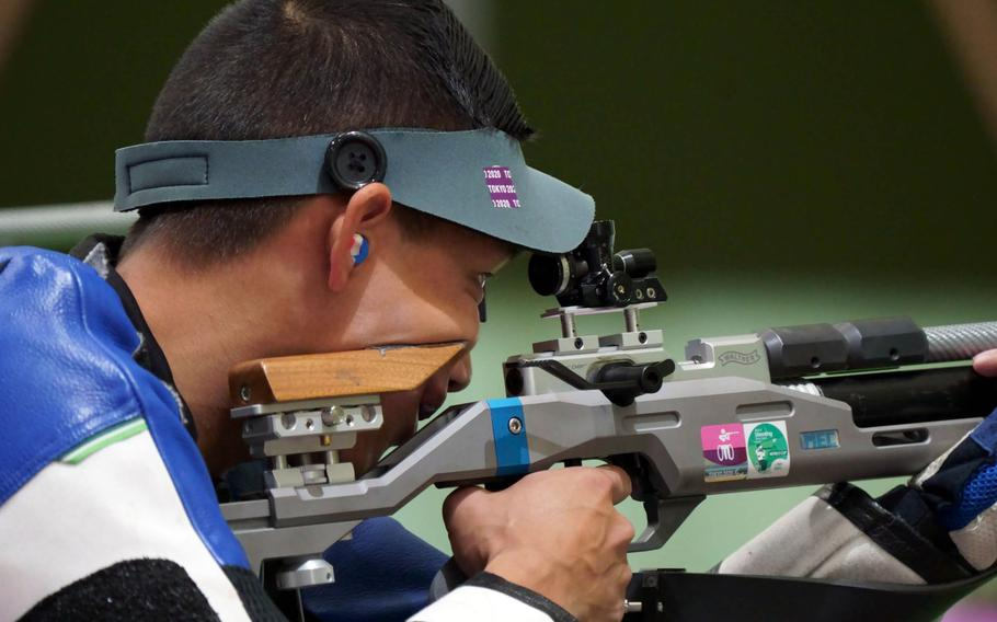 U.S. Army Staff Sgt. Kevin Nguyen prepares to fire during a Tokyo Paralympics shooting event at Camp Asaka, Japan, Wednesday, Sept. 1, 2021.