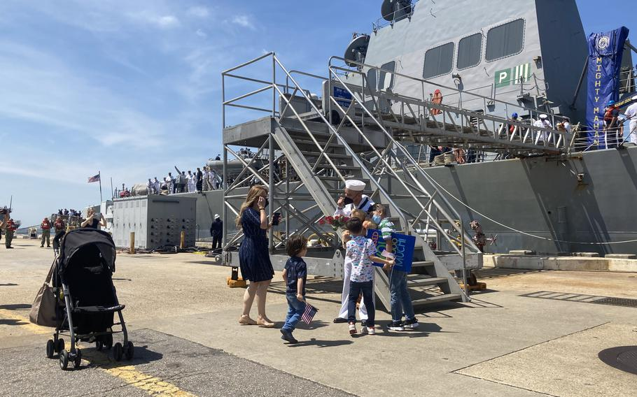 Petty Officer 3rd Class Jose Corral Salomon greets his family at USS Mahan's homecoming on Friday, Aug. 6, 2021.
