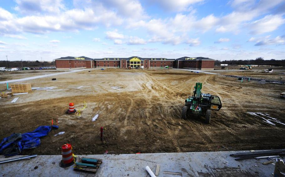 In this Dec. 31, 2013, file photo, new barracks and a mess hall are under construction at Camp Atterbury in Edinburgh, Ind. More than 6,600Afghan refugeeswho began arriving at the Indiana National Guard's Camp Atterbury training post nearly six weeks ago are awaiting resettlement.