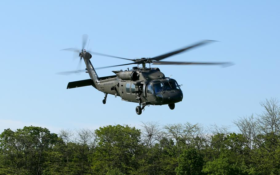 A U.S. Army UH-60 Black Hawk helicopter takes off from the Babadag Training Area, Romania, in May 2021. A Black Hawk was forced to make an emergency landing on a Bucharest street July 15, 2021, after experiencing a mechanical problem, Army officials in Europe and local officials said.
