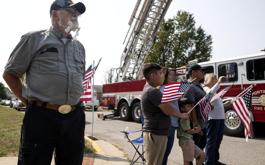 Donnie Louthain watches the funeral procession for Marine Corps Cpl. Humberto Sanchez on Sunday, Sept. 12, 2021, in Logansport, Ind.