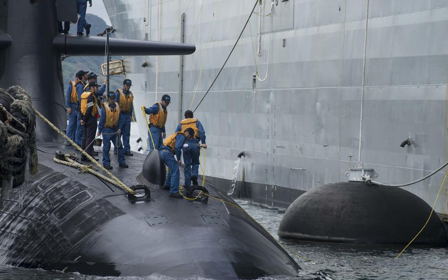 Sailors assigned to the Japan Maritime Self-Defense Force submarine JS Soryu (SS-501) moor port-side along the U.S. Navy submarine tender USS Frank Cable (AS 40) on June 10, 2018, in Polaris Point, Guam.