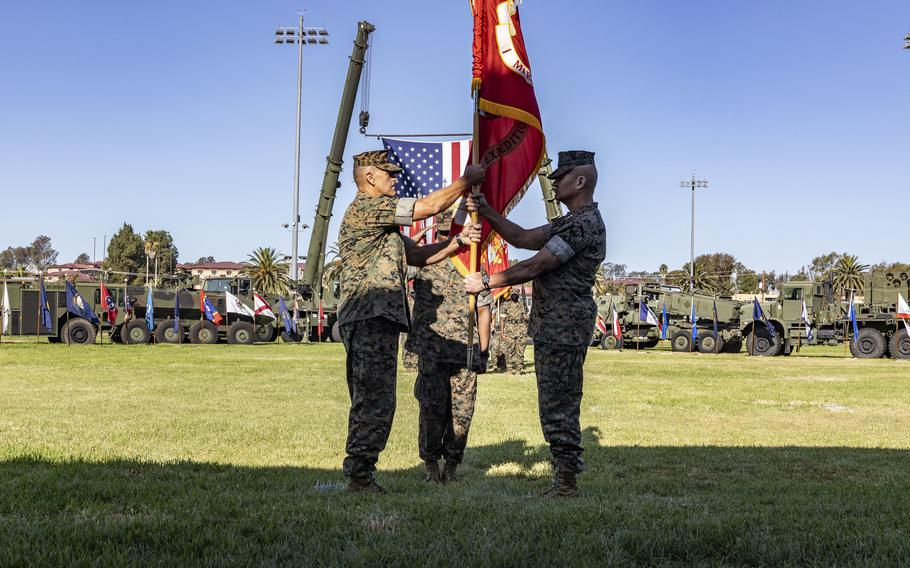 Lt. Gen. Karsten S. Heckl, former commanding general, I Marine Expeditionary Force (MEF), passes the colors to Lt. Gen. George W. Smith Jr., signifying the change of command of I MEF during a formal ceremony Sept. 23, 2021, at the 11 Area Parade Deck on Marine Corps Base Camp Pendleton, Calif.