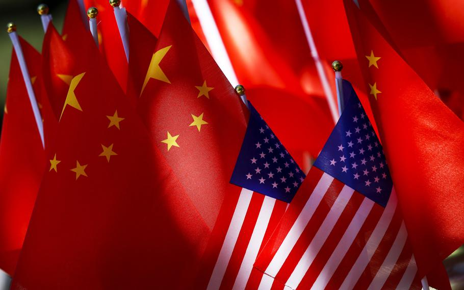 """American flags are displayed together with Chinese flags in Beijing on Sept. 16, 2018. China's Ministry of Commerce said Thursday, June 10, 2021,  that the Biden administration's move to revoke Trump administration executive orders intended to ban apps like TikTok and WeChat was a """"positive step."""""""