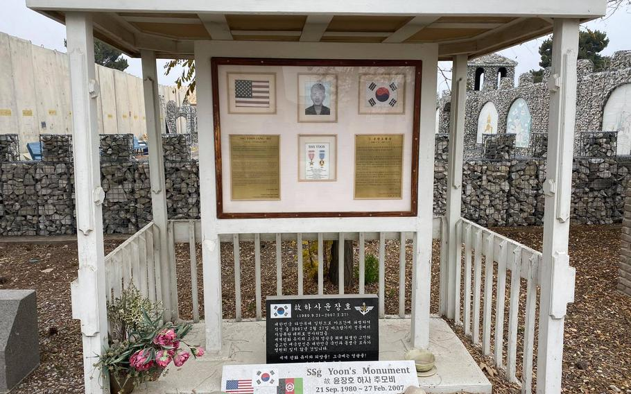 A memorial to a Korean soldier killed in Afghanistan stands on Bagram Airfield, Afghanistan in an undated photo. Troops, civilians and contractors attempted to bring home mementos and memorials prior to the transfer of the base to Afghan security forces.