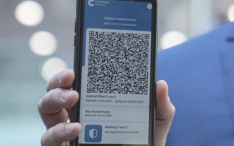 Jens Spahn, Germany's Federal Minister of Health, shows the app for the digital vaccination certificate at the regular press conference on the Corona situation in Berlin, Germany, Thursday, June 10, 2021.