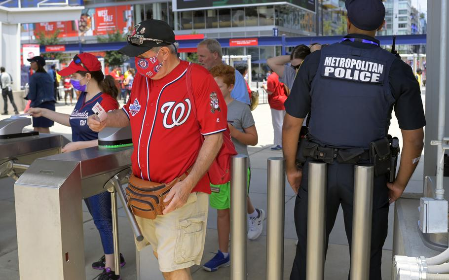Fans return to Nationals Park on July 18, 2021, hours after a Saturday night shooting outside the ballpark.