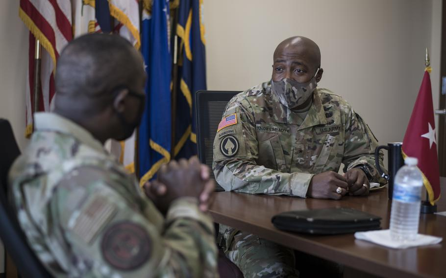 U.S. Army Brig. Gen. Kodjo Knox-Limbacker, right, adjutant general, Virgin Islands National Guard (VING), speaks with U.S. Air Force Chief Master Sgt. Maurice L. Williams, command chief, Air National Guard, during a visit to the VING Joint Force Headquarters in Kingshill, St. Croix, April 11, 2021. Knox-Limbacker recently was promoted the rank of major general.