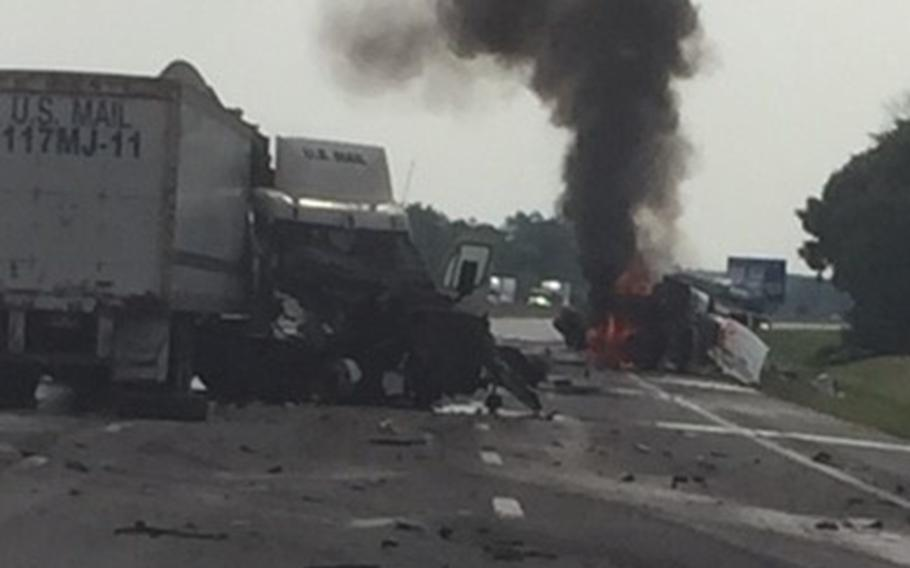 A truck is on fire while two other trucks lay in ruins on a highway near Sandusky, Ohio, on Aug. 20, 2018. Randy Wilson received the Air Force Civilian Award for Valor after he helped pull the driver from the burning rig just before it exploded.