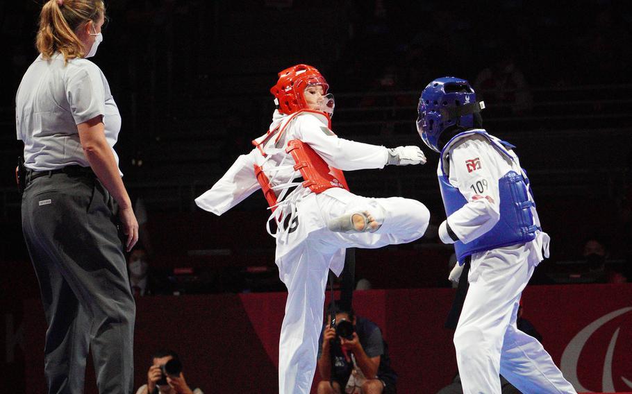 Afghan Taekwondo athlete Zakia Khudadadi, in red, takes on Uzbek Ziyodakhon Isakova during the Tokyo Paralympics in Chiba prefecture, Japan, Thursday, Sept. 2, 2021.