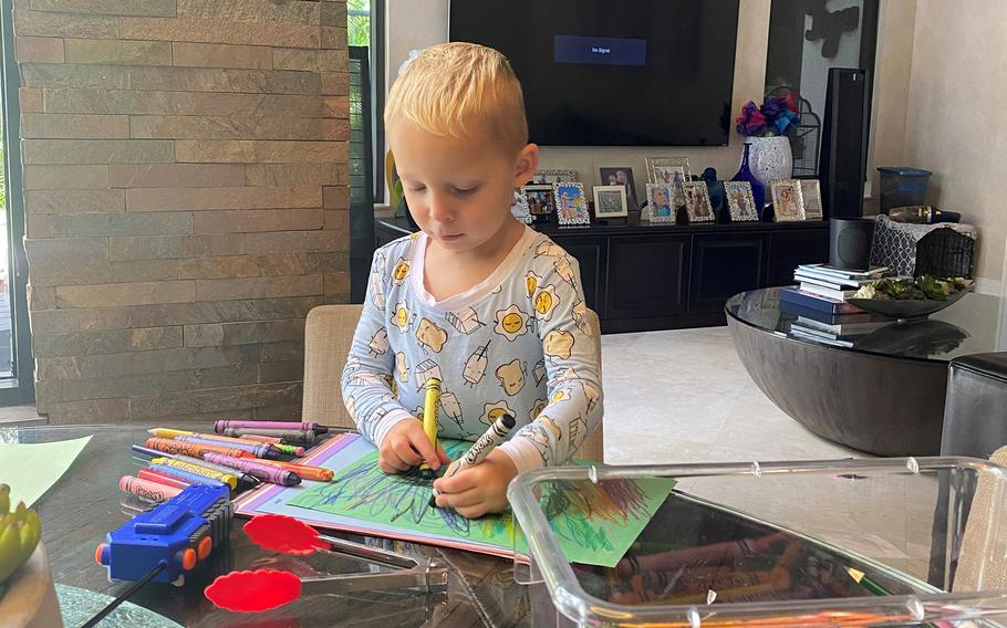 Hudson Byrnes, 4, crafting cards for rescue workers at his home in Plantation, Fla., about 20 miles from Champlain Towers South.