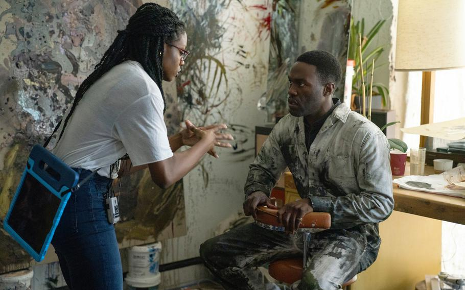 """This image released by Universal Pictures director Nia DaCosta, left, with actor Yahya Abdul-Mateen II on the set of """"Candyman."""""""