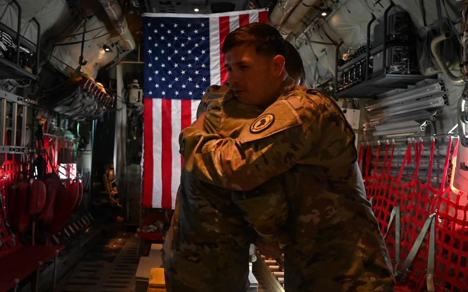 U.S. Army Col. Timothy MacDonald, operations director, Combined Joint Task Force — Horn of Africa, re-administers the Oath of Enlistment to Sgt. 1st Class Nathan Phelps, from Locke, N.Y., while aboard a KC-130J over East Africa, Sept. 11, 2021.