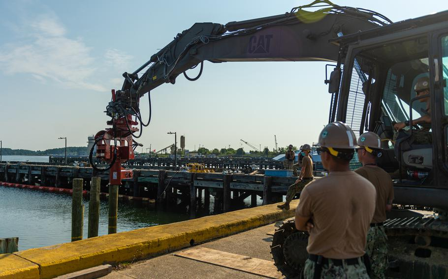 Sailors attached to Naval Mobile Construction Battalion (NMCB) 133, drive a pilon into the sea bed as part of a Pier Damage Repair scenario onboard Joint Expeditionary Base Little Creek-Fort Story in Virginia Beach, Virginia, during Large Scale Exercise 2021. LSE 2021 demonstrates the Navy's ability to employ precise, lethal, and overwhelming force globally across three naval component commands, five numbered fleets and 17 time zones.