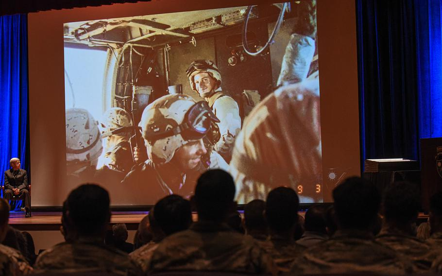 Current U.S. Army Rangers look at photos of 3rd Battalion, 75th Ranger Regiment Rangers in action in Somalia in 1993 before 18 former members of the unit were awarded Silver Stars for their actions in the infamous Battle of Mogadishu that year.