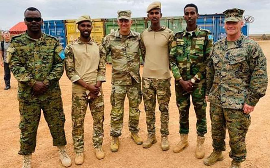 U.S. Africa Command's Gen. Stephen Townsend, third from left, poses for a photo during a visit last week to a Somali military base 60 miles outside of Mogadishu in Baledogle, a site where U.S. forces came under attack in 2019. Townsend met with an elite Somali infantry unit.