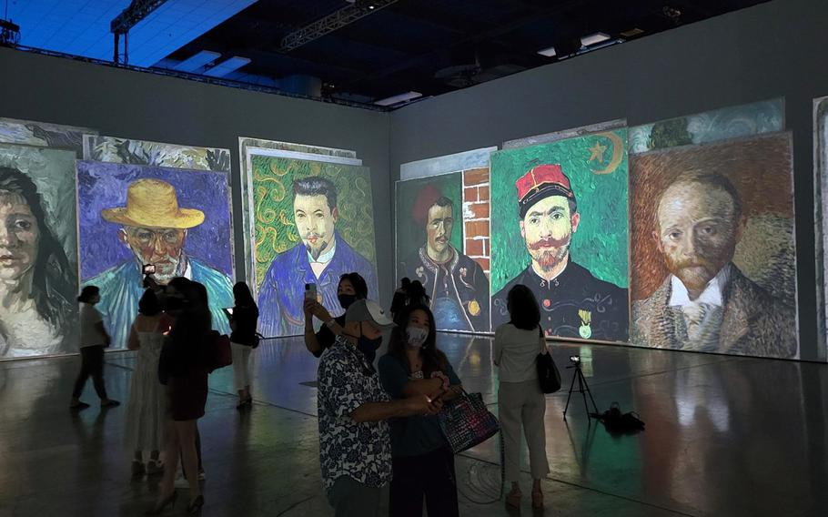 An assemblage of portraits of friends and acquaintances by Vincent Van Gogh are displayed at Beyond Van Gogh: The Immersive Experience, running through Sept. 26, 2021, at the Honolulu Convention Center.