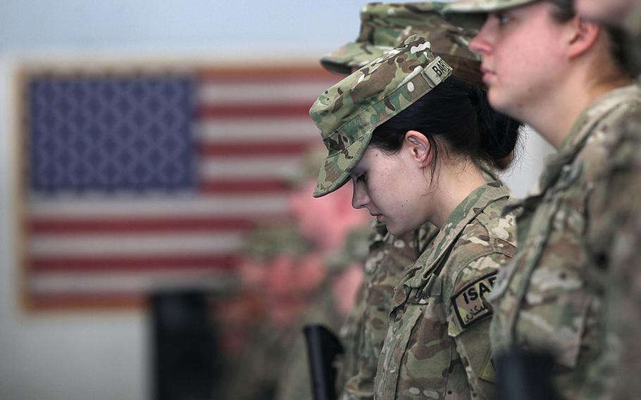 Oklahoma National Guard soldier Pfc. Sarah Bartodei, 19, and fellow soldiers gather to receive their combat action patches on the anniversary of the Sept. 11, 2001, terrorist attacks on Sept. 11, 2011, at Bagram Air Field, Afghanistan.