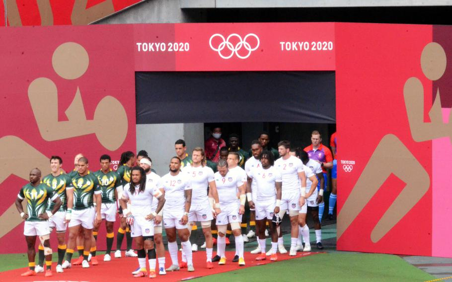 The U.S. Eagles and the South African Blitzboks prepare to enter Tokyo Stadium for an Olympic rugby sevens clash, Tuesday, July 27, 2021.