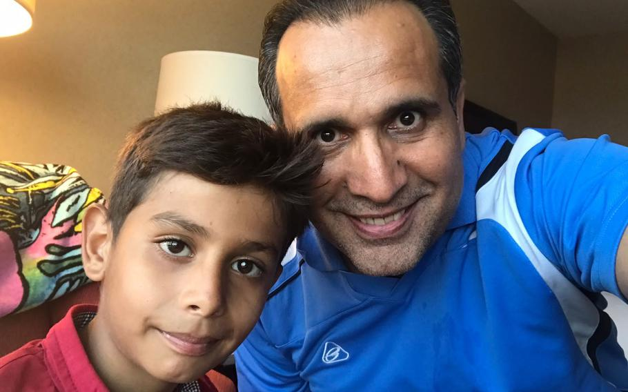 Noman Mujtaba, 10, and his adoptive father, Bahaudin Mujtaba, pose for a selfie Aug. 28, 2021, after being reunited in Virginia following Noman's harrowing evacuation from Kabul, Afghanistan. The family was nearing the end of the adoption process when Kabul fell to the Taliban in mid-August.