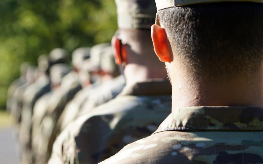 Soldiers stand in formation before a training event at Fort Knox, Ky., Sept. 9, 2021. The Army can now opt to allow enlisted soldiers with 20 or more years of service who are facing separation for misconduct to retire at lower rank, according to new service policy.