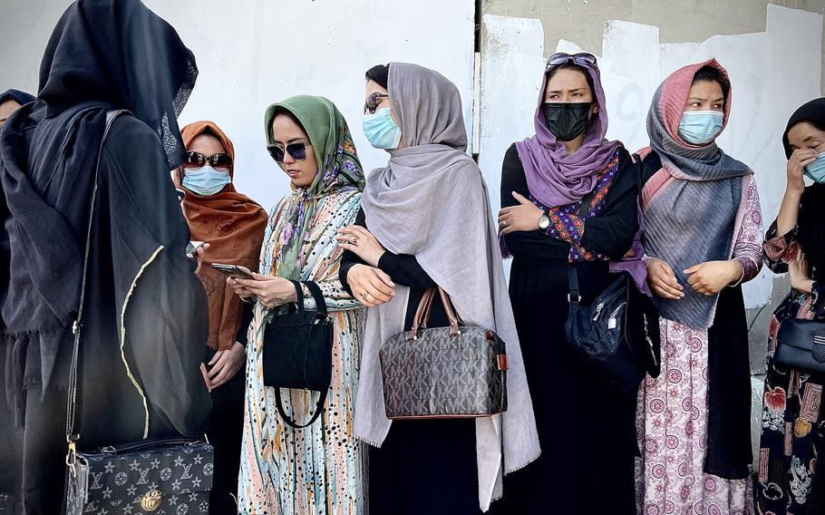 Female protesters gather in downtown Kabul after a brutal Taliban crackdown on demonstrations. After reports that many of the other women who planned to join them had already been detained or beaten by Taliban fighters, the women debated whether to push forward on their own.