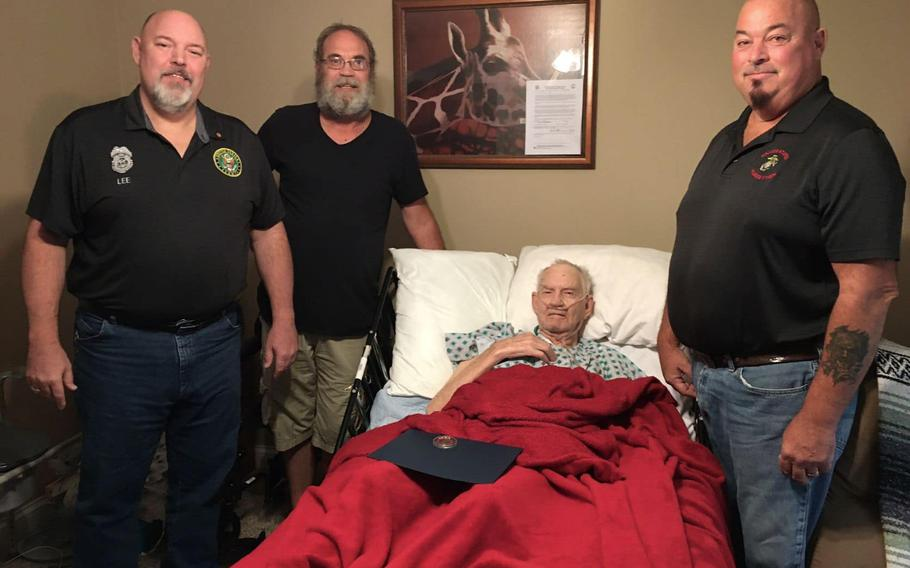 U.S. Army veteran Joseph W. Fulkerson receives a flag-pinning ceremony for his military service at Hospice and Palliative Care of Western Kentucky.