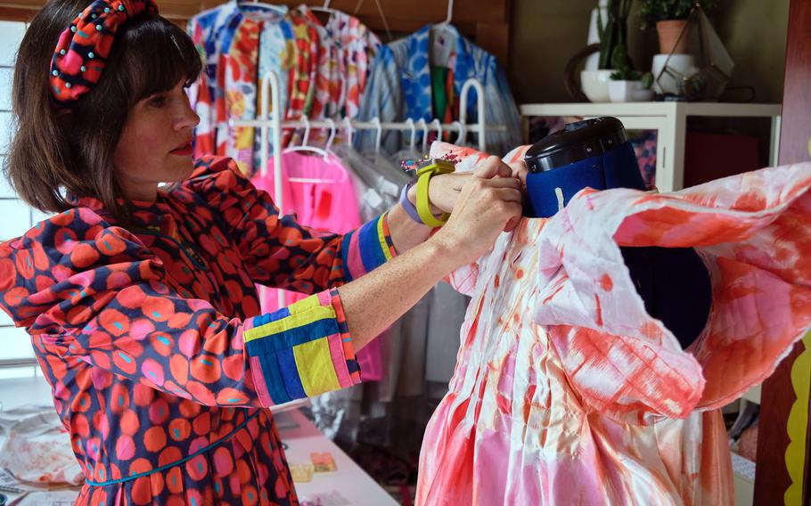 """Navy spouse Katie Kortman shows off her home design studio at Yokosuka Naval Base, Japan, Sept. 30, 2021. She is a contestant on the upcoming season of Bravo's fashion competition series """"Project Runway."""""""