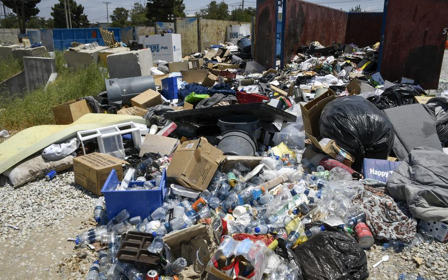 Afghan soldiers sorted through trash left at Bagram Airfield, Afghanistan, July 7, 2021. U.S. troops, contractors and civilians destroyed much of the goods left behind before transferring the base, which rankled the Afghan soldiers.