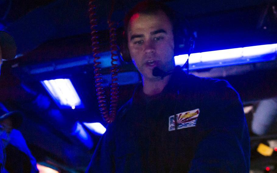 Ridge Hannemann Alkonis, then a junior-grade lieutenant, works aboard the guided-missile destroyer USS Fitzgerald in the Timor Sea, July 9, 2015.