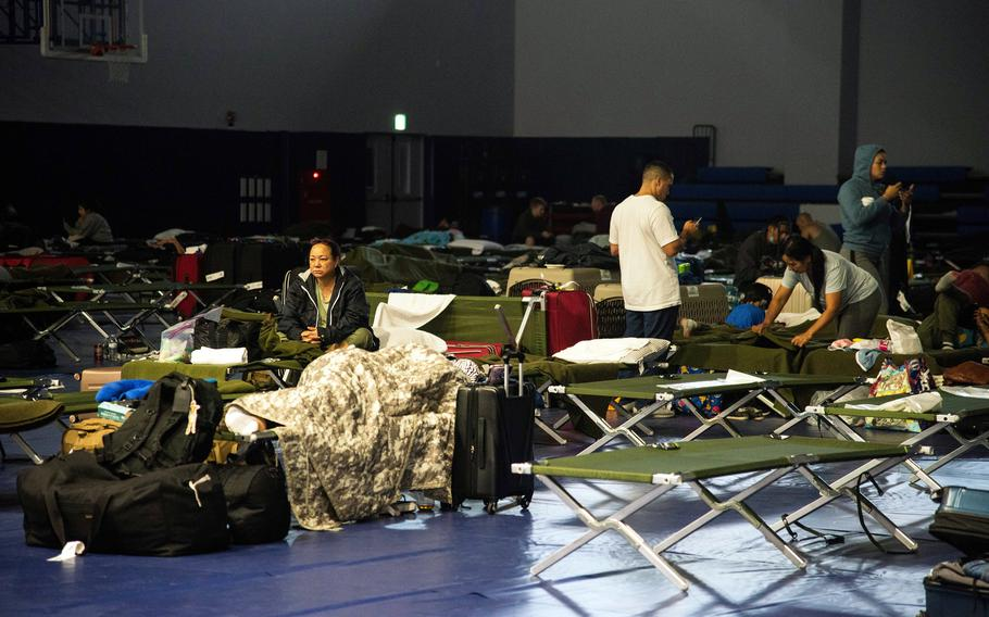 Many delayed Patriot Express passengers slept on cots inside a gym at Marine Corps Air Station Iwakuni, Japan, after a hard landing on July 13, 2021, forced their flight to return to Tokyo for repairs.