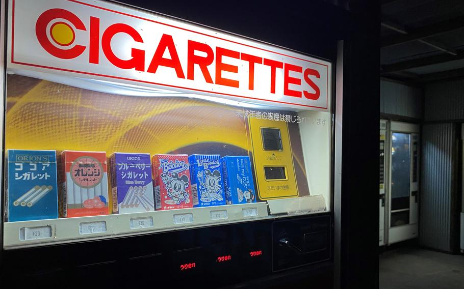 Candy cigarettes are just one of the nostalgic items you'll find in the scores of vintage vending machines outside Used Tire Market in Sagamihara, Japan.