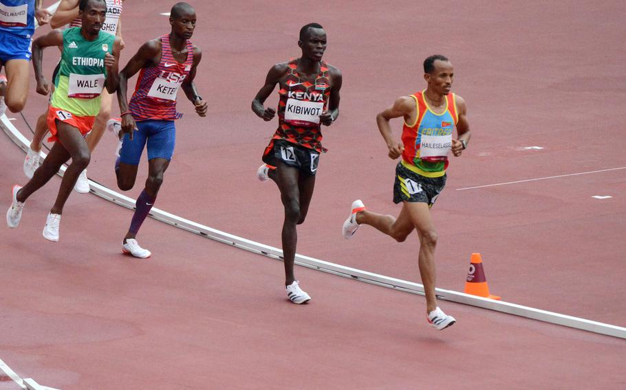 Army Spc. Benard Keter, in third place, nears the end of his heat of the Olympic men's 3000-meter steeplechase at Tokyo's National Stadium, Friday, July 30, 2021.