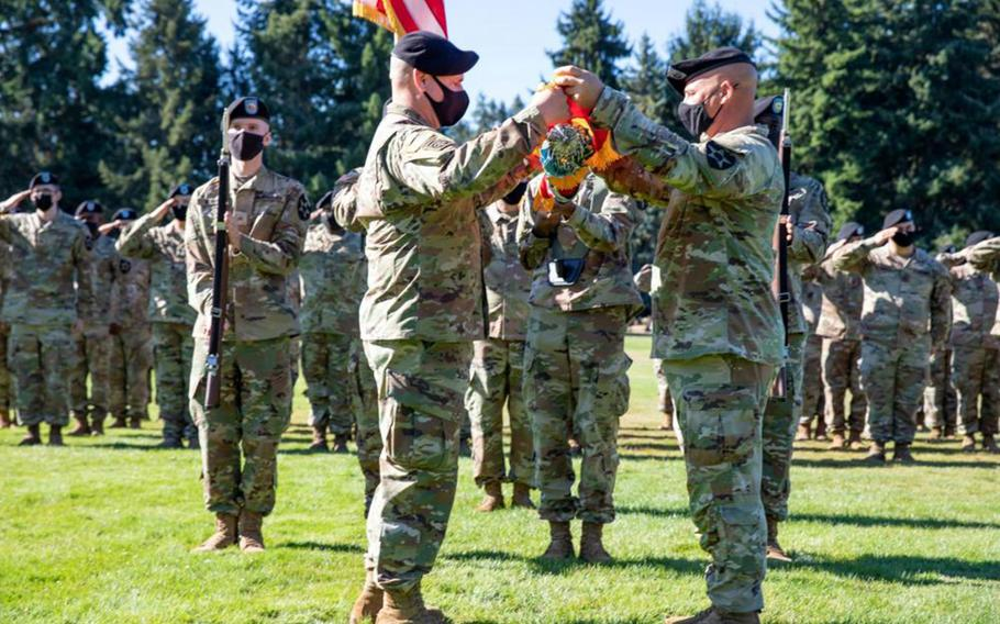 Col. David Pasquale and Command Sgt. Maj. Patrick Whitetree case the 2nd Infantry Division Artillery colors at Joint Base Lewis-McChord, Wash., Sept. 8, 2021. The unit is relocating to Camp Humphreys, South Korea.